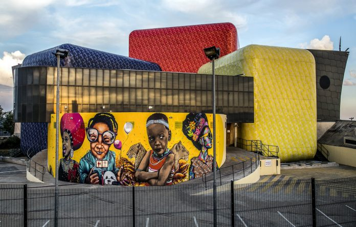 The Soweto Theatre wall was transformed by artists participating in the Ubuhle Bendalo urban art residency last week. Photo: Mpho Mokgadi