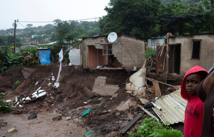 Damaged houses after heavy rains caused flooding in Marianhill
