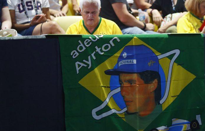 A Brazilian flag with an image of late Brazilian former Formula One World Champion Ayrton Senna.