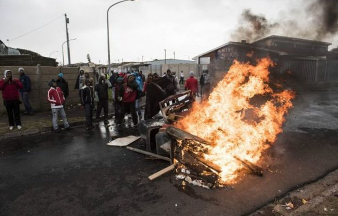 South Africa goes up in flames a month before elections.