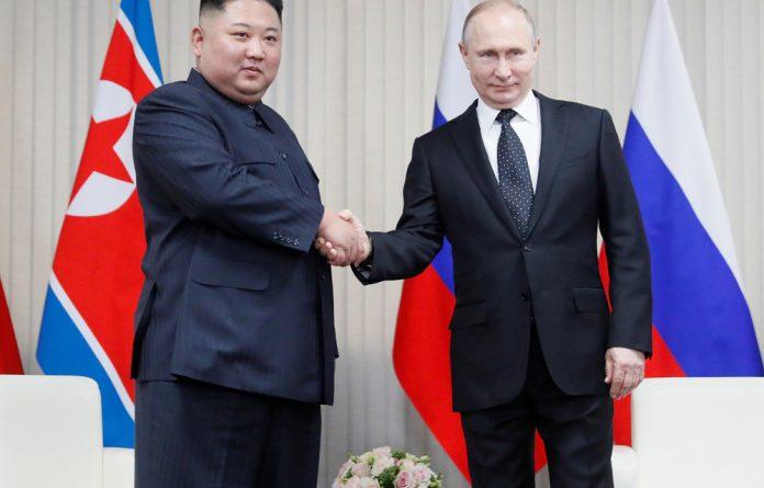 President Vladimir Putin and North Korean leader Kim Jong Un shake hands during their talks at Far East Federal University on Russky Island in Vladivostok