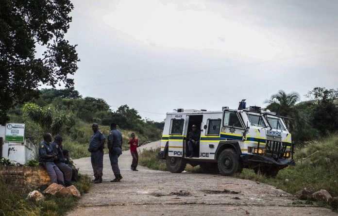 On guard: Police in Umdoni in KwaZulu-Natal had to clear the roads for voters to make their way to polling stations.
