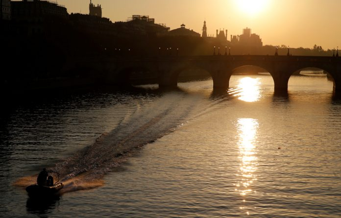 The sun rises above the Seine River skyline in central Paris. Safety limits were most frequently exceeded in Asia and Africa