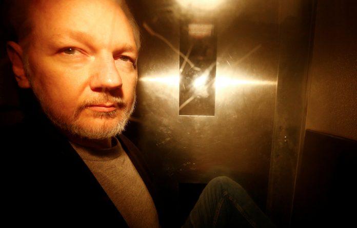 WikiLeaks founder Julian Assange leaves Southwark Crown Court after being sentenced in London.