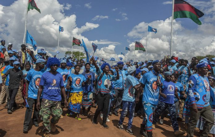 Blue brigade: Supporters of Malawi's President Peter Mutharika and his Democratic Progressive Party arrive for the launch of the party's manifesto and election campaign in Lilongwe last month.