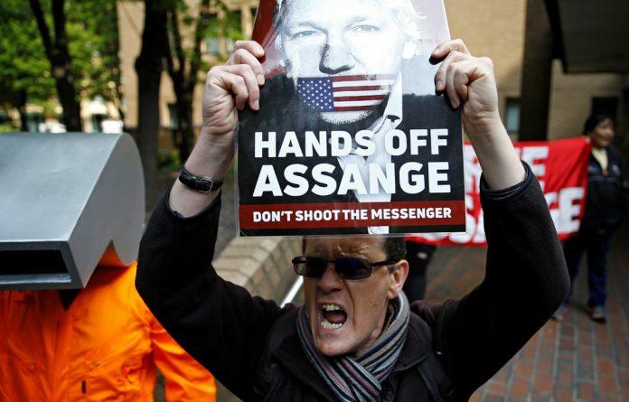 People protest outside Southwark Crown Court in London where WikiLeaks founder Julian Assange was sentenced.