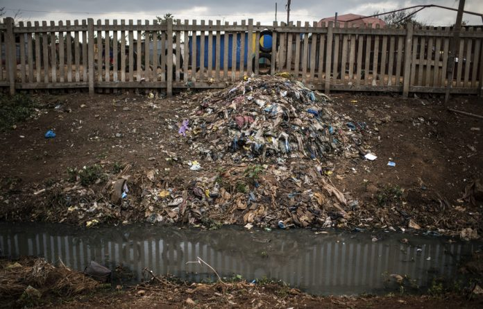 Rubbish litters the landscape of Bekkersdal.
