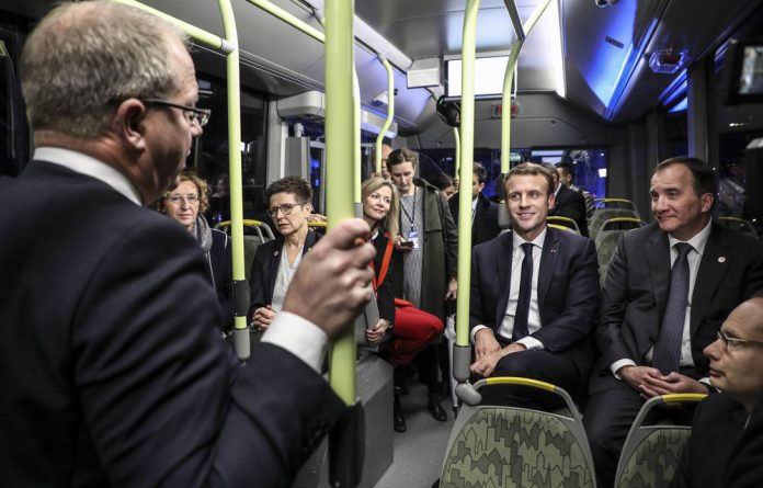 France's President Emmanuel Macron and Sweden's Prime Minister Stefan Löfven travel by bus during the European Social Summit. Swedish politicians use public transport all the time.