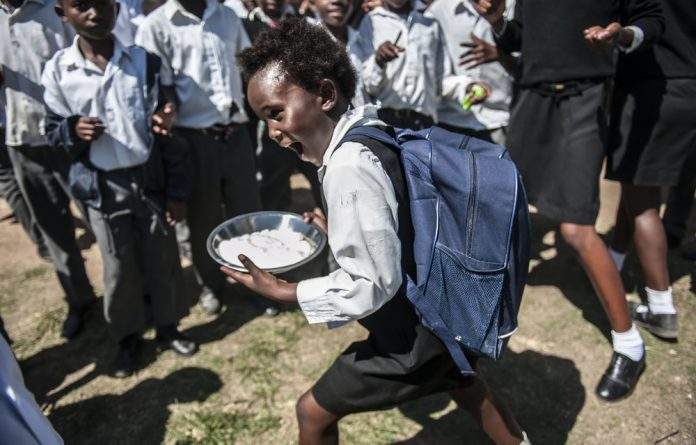 Undernourished: Children get a meal at a school in Eastern Cape