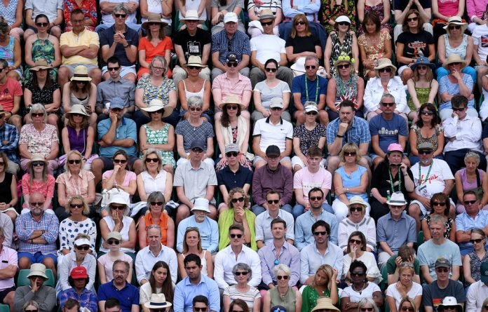 Where's Wally? Spectators watch a match at Wimbledon. Tickets are expensive
