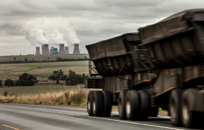 The tax puts a price on releasing greenhouse gases from fuel combustion and industrial processes.