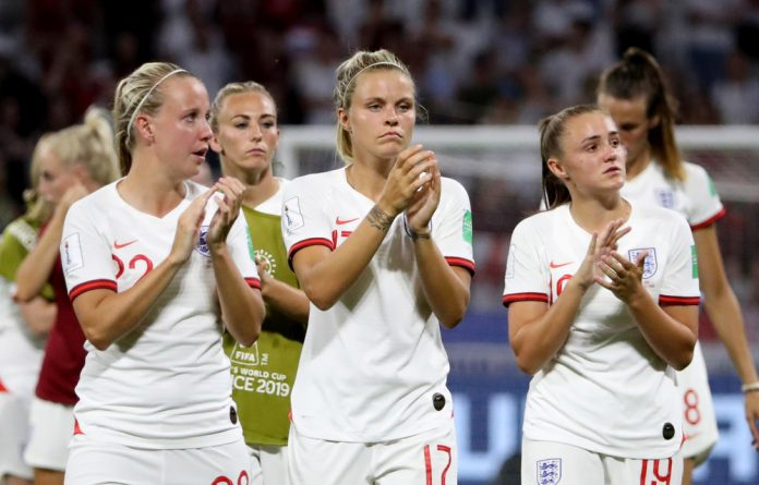 England's Rachel Daly and team mates applaud fans after their defeat to the United States.