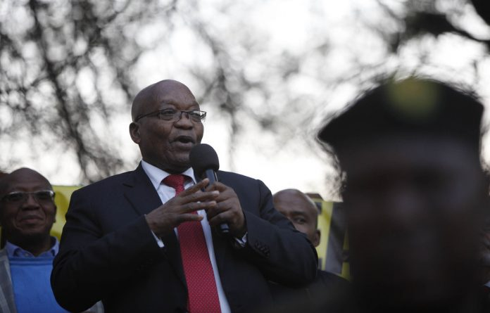 Former president Jacob Zuma addressing his supporters after day 1 of his appearance at the Zondo comission.