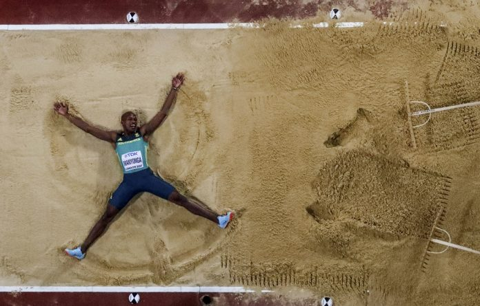 Sand angels: South Africa's long jumper Luvo Manyonga.