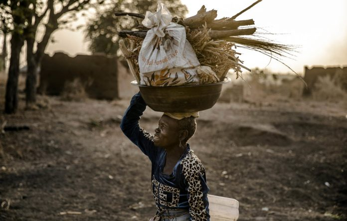 Labouring: African women constitute 40% of the agricultural workforce and produce 70% of the continent's food. Photo: Luis Tato/AFP