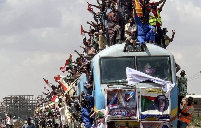 Initial victory: Sudan's citizens celebrate the power sharing deal.