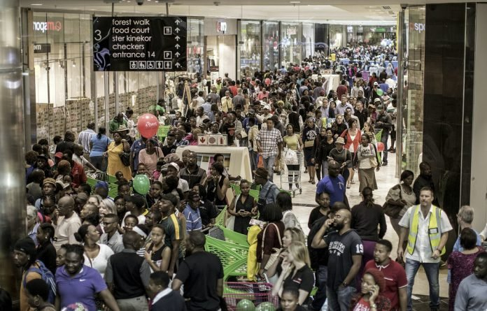 Crowds at the Mall of Africa. The recently signed National Credit Amendment Act aims to provide debt relief for over-indebted consumers who earn less than R7500 a month. It could have a knock-on effect on retailers.