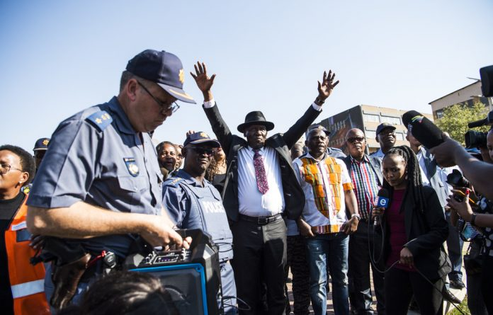 Come in peace: Police Minister Bheki Cele met with hostel residents and has reported to Cabinet.