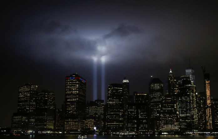 The Tribute in Light installation illuminates lower Manhattan as seen from the borough of Brooklyn