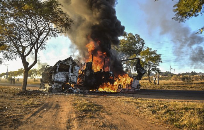 Road to hell: More than a thousand trucks have been destroyed in the past year by people wanting to push foreign drivers out of their jobs.