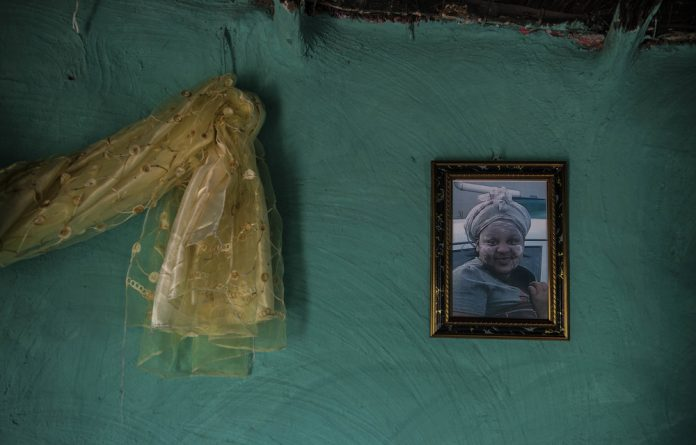Mementoes: A picture of Aviwe Wellem hangs on a wall at the homestead.
