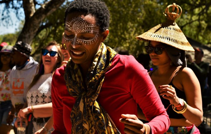 Festivalgoers get down and boogie at the Okavango Delta Music Festival.
