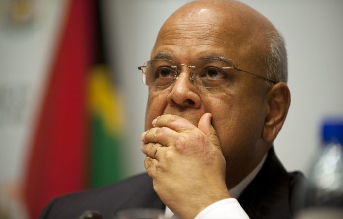 """Public Enterprises Minister Pravin Gordhan has been accused by the Economic Freedom Fighters of being a member of a """"cabal""""."""