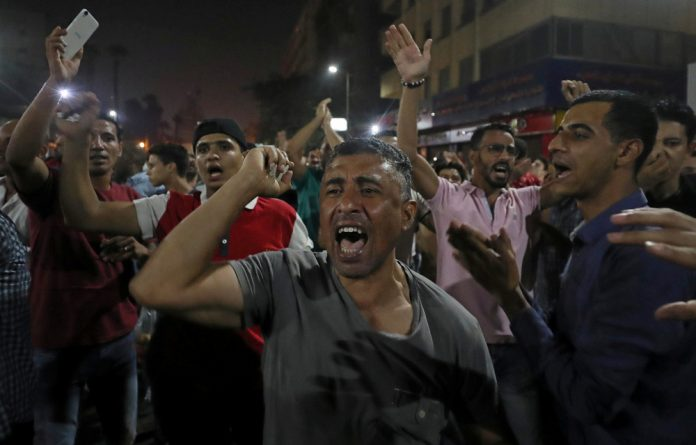 Groups of protesters gather in central Cairo shouting anti-government slogans.
