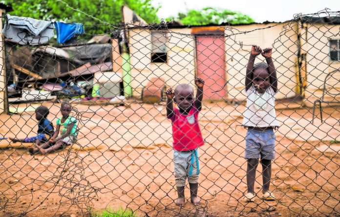 Making ends meet: Lindiswa Mbele's children playing outside. The family survives on a child support grant of R840 a month.