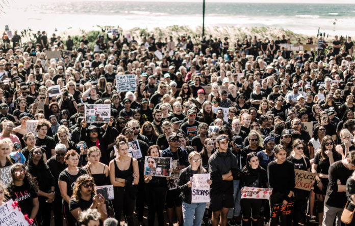 Protest: Hundreds of people gathered at Durban's North Beach recently in solidarity with women who have been violated and killed.