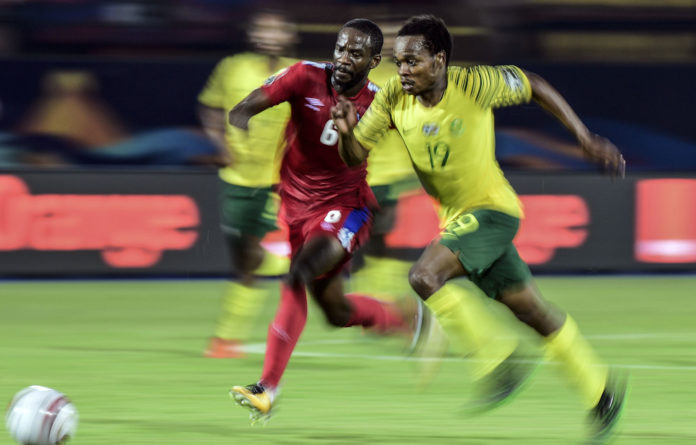 Mixed fortunes: Banyana Banyana had happier times last year and Bafana forward Percy Tau is marked by Namibia's midfielder Larry Horaeb during a group match in this year's Africa Cup of Nations.