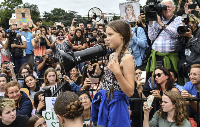Greta Thunberg addresses a crowd at the Global Climate Strike against the use of fossil fuels