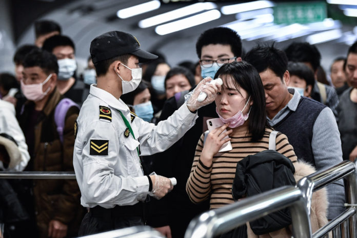 Chinese citizens wear masks to defend against the coronavirus