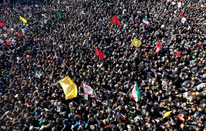 Mourned: Iranians gather during the final stage of funeral processions for the country's powerful general