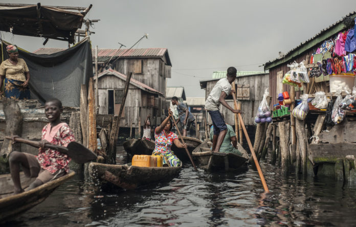 Vive la francaphonie! Residents navigate the waterways of Makoko. The area is home to about 100000 French speakers.
