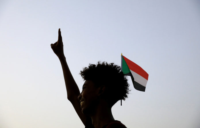 Smiles on the rise:to Khartoum was hit by celebration after the signing by generals and opposition leaders of the documents that will govern Sudan's three-year transition to civilian rule.