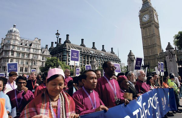 Rowan Williams front, sixth from left leads a march through central London last month calling on world leaders to keep their promises to deliver the Millennium Development Goals by 2015. Photograph: Sang Tan/AP