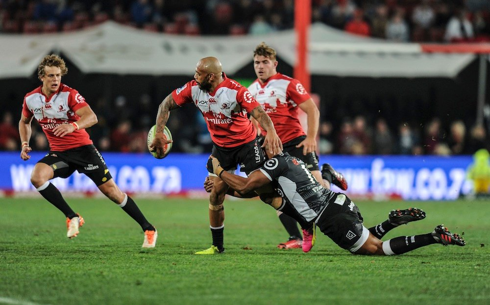 Lionel Mapoe of Lions is tackled by JP Pietersen of Sharks during the Super Rugby match between Emirates Lions and Cell C Sharks at Emirates Airline Park.  Gallo Images/Getty Images