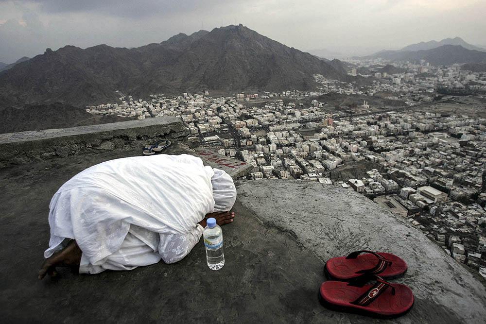 A girl prays on the Mount of Light on January 16 2005 as part of the annual Hajj pilgrimage in Jebel al-Noor, Saudi Arabia. Abid Katib, Getty