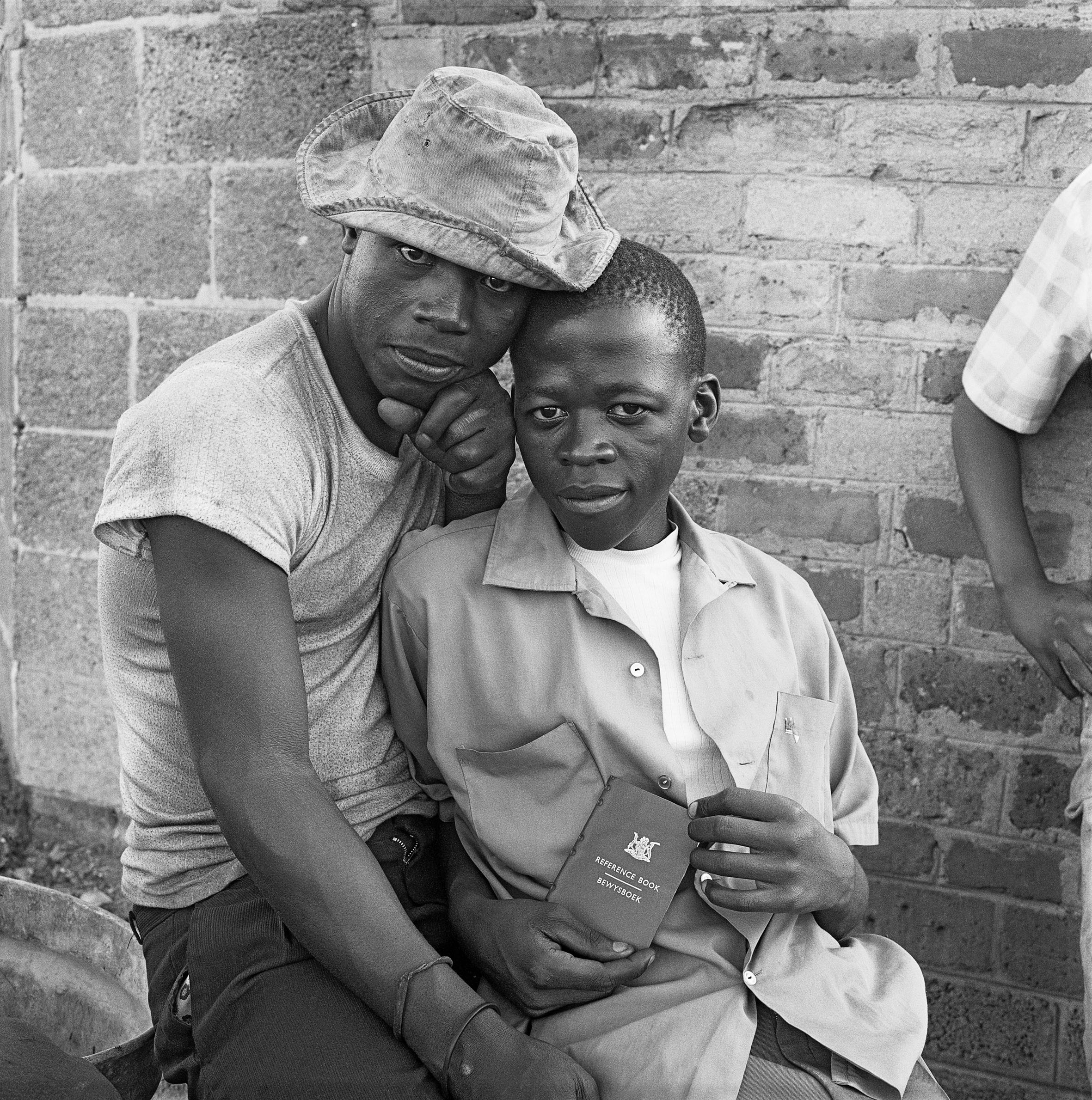 Young men with dompas an Identity document every African had to carry, White City, Jabavu, Soweto, 1972