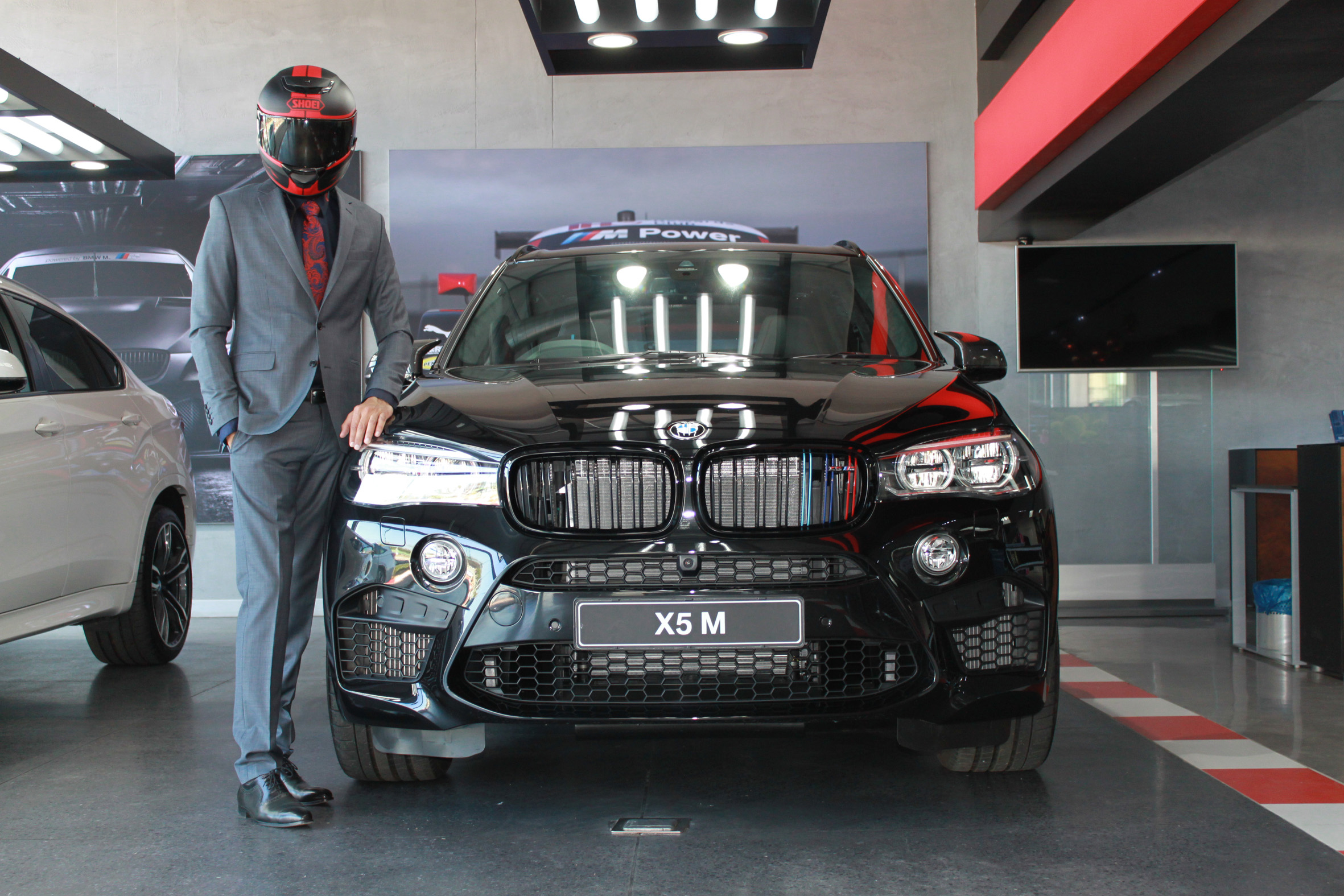 The Singh and the new BMW X5 M, on their way to seeing what the car do