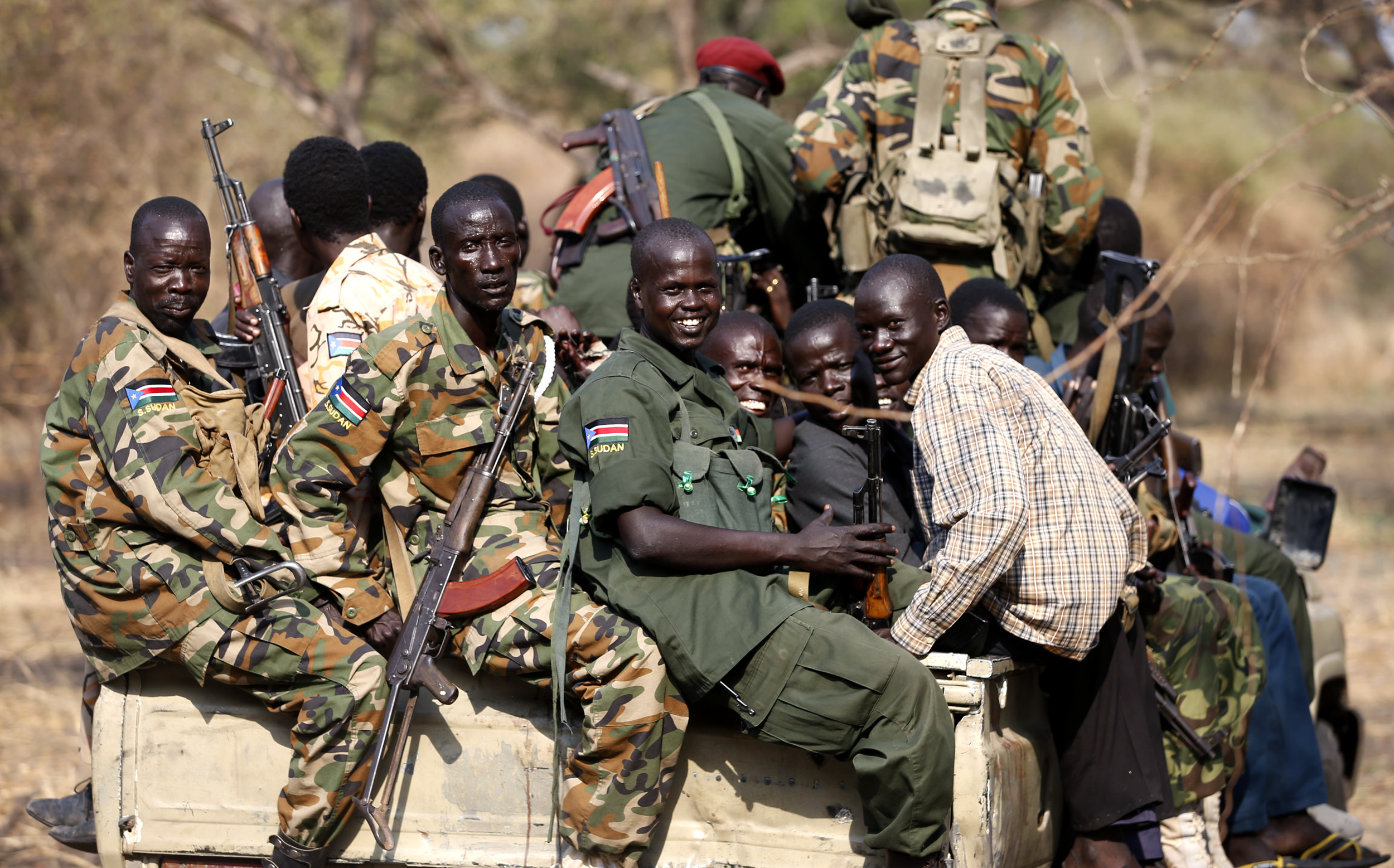 South Sudan's rebels with weapons travel in a truck in a rebel-controlled territory in Jonglei State. Reuters/Goran Tomasevic